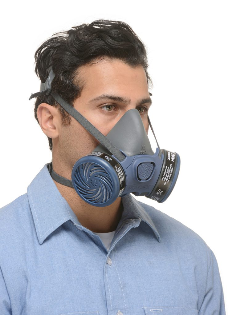 view from the side of a man wearing half-face reusable respirator mask