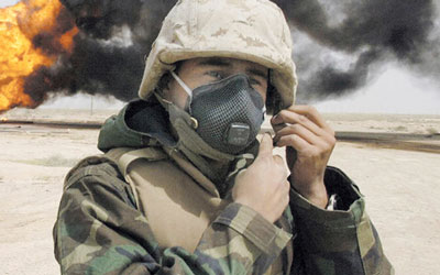 soldier putting on respirator face mask during fire