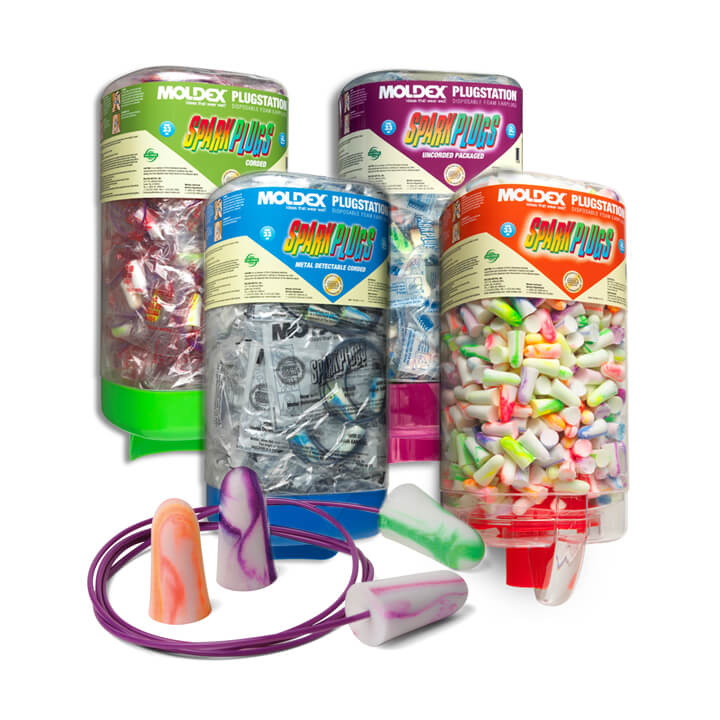 four dispensers of disposable foam earplugs behind a couple of pairs of colorful earplugs